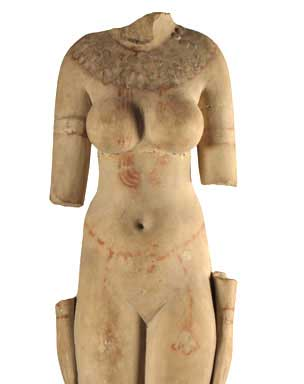 Egyptian limestone statue of a naked female Hathoric figure from Naukratis, dating to the Ptolemaic era. British Museum.