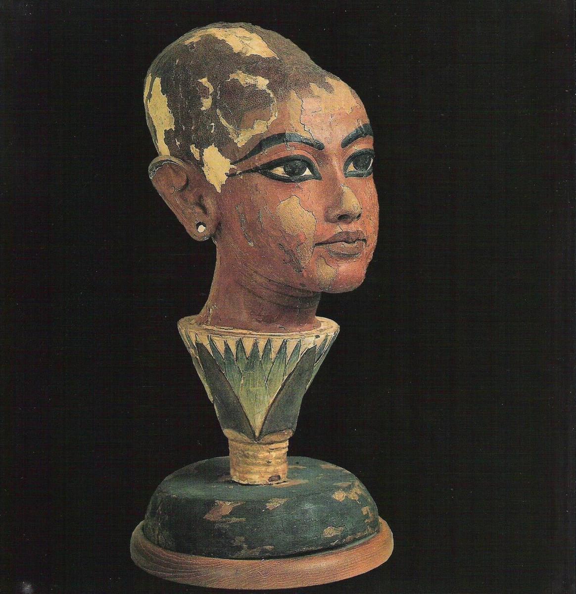 Tutankhamun as a young Sun God emerging from a lotus flower. Cairo Museum.