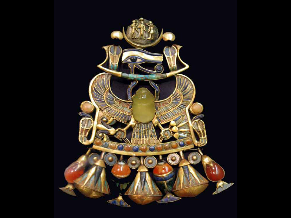 Pectoral adorned with yellow silicate scarab. c 1323 BC, tomb of Tutankhamun, Valley of the Kings, Egypt. Now at the Cairo Museum.