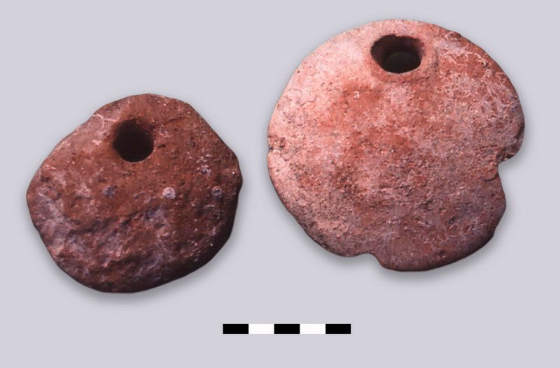 Fig. 44. Typical examples of clay loom weights of south-aegean/Minoan type of the beginning of the Late Bronze Age.