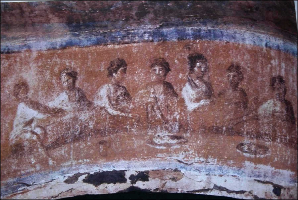 The fresco in the central arch at the back of the Greek Chapel shows a banquet.
