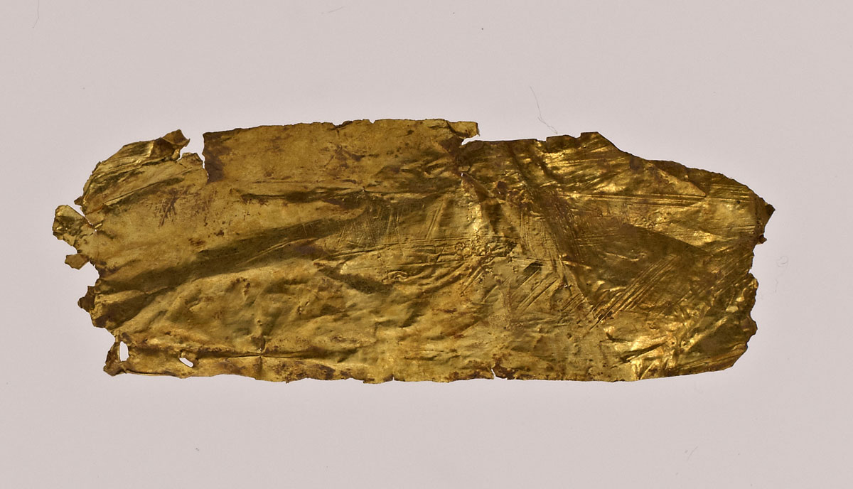 Fig. 6. Wrapped golden sheet. When unwrapped an engraved ship was revealed.