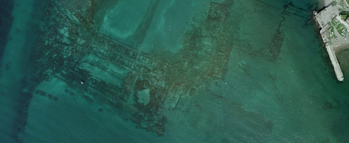 The sunken remains of the Roman city of Baiae and Portus Julius port are obvious even from an aerial view of the area off the coast in the Bay of Naples.