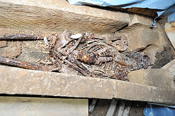 The bones of an individual inside the sarcophagus found beneath Lincoln Castle. Photo: © Lincolnshire County Council.