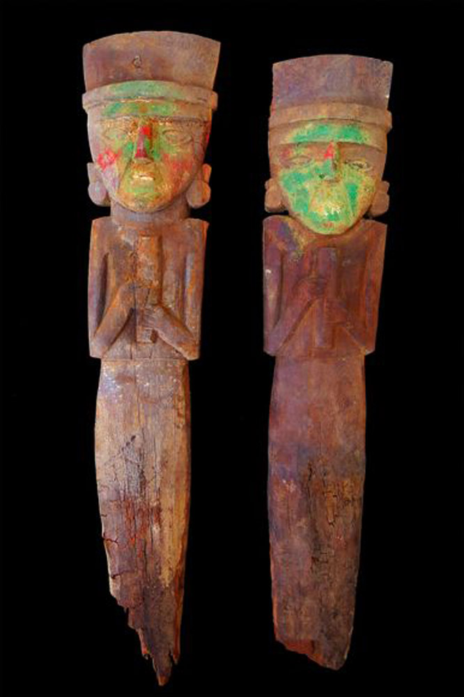 Statuettes of figures holding flute. Wood, stained with cinnabar and copper. Chimú culture, Peru, 15-16th c. AD. Photo: Matthew Helmer/NGS.