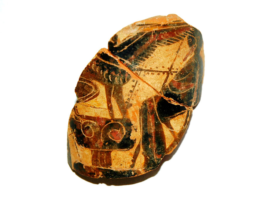 Fig. 15. Trapeza: Fragment of an Attic black-figured lekythos with a depiction of Oedipus with sphinx (500-475 BC). The earliest finds dated to late 6th – early 5th c. BC, are mainly related to fragmentary remains or come from disturbed layers of later interventions.