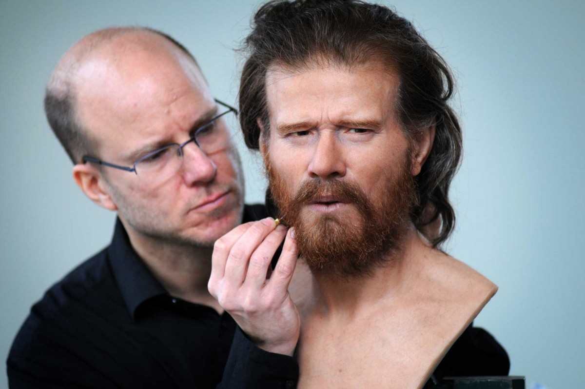 Sculptor Oscar Nilsson puts the finishing touched to a head reconstructed from a male neolithic skeleton unearthed near the site. Photo: National Trust Press Office