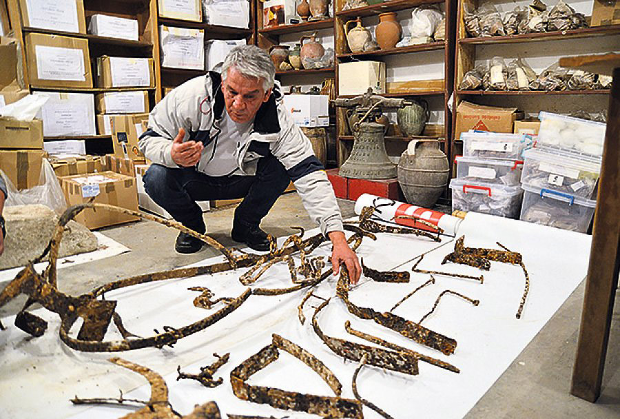 Archaeologist Zoran Mitic alongside the remains of the Tracian chariot he located at Pirot, Serbia. Photo: Kurir/Tanjug