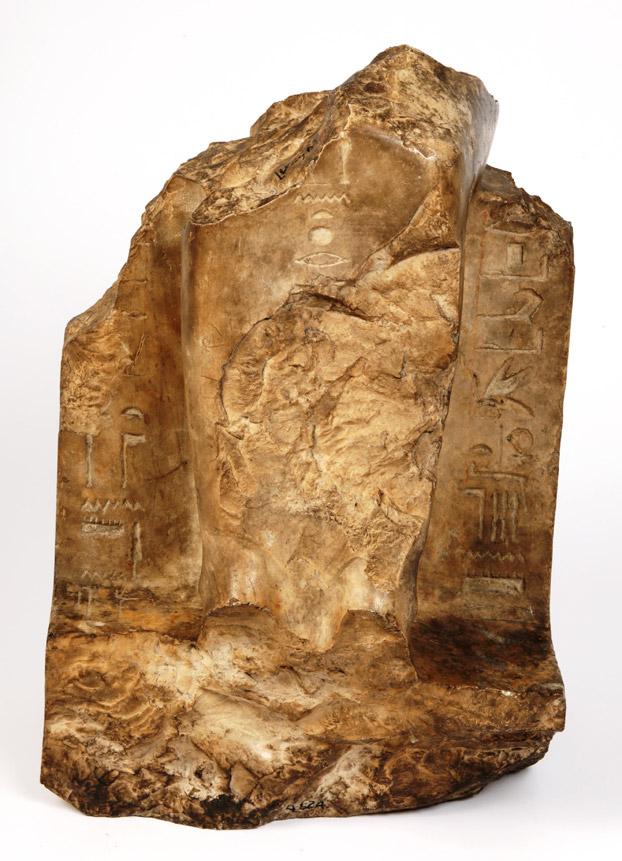 Seated figure. Limestone. Deir el-Bahari, Egypt. Manchester Museum UK, acc,no. 4624. Photo: Manchester Museum.