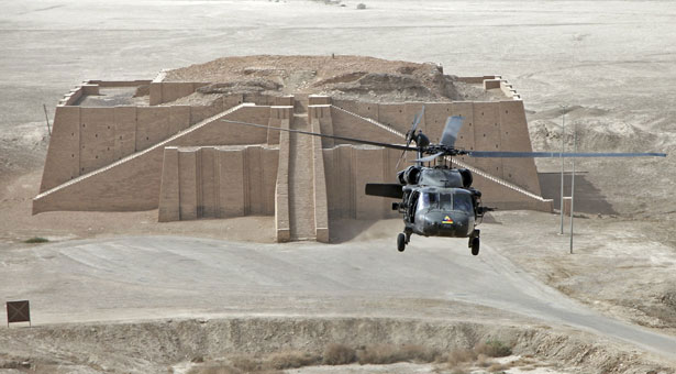 A U.S. Army helicopter hovers near the ancient Ziggurat of Ur, a temple on the outskirts of Nasiriyah, Iraq. (Credit: USA Today)