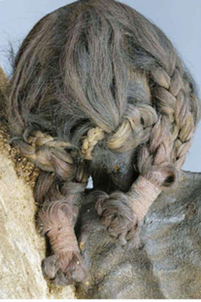 Backside view of a mummified Inca woman's head, demonstrated an elaborate hairstyle. Archaeological Collection of the State of Bavaria in Munich. Photo: PLOS ONE/ 2014 Panzer et al.