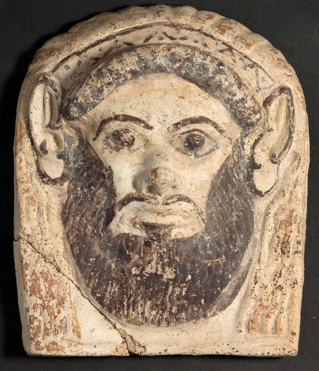 Antefix with Silenus mask. End of 6th - beginning of 5th century BC. Giardini Naxos Museo Archeologico.