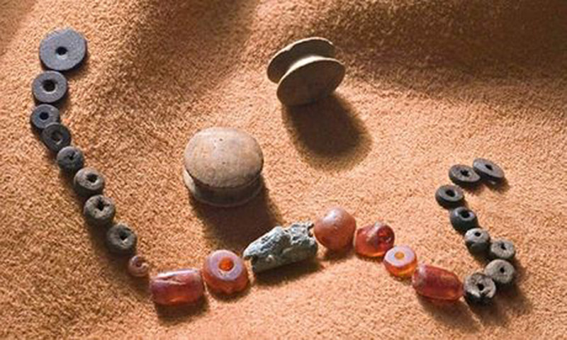 Beads and ear studs found among the burial items in Whitehorse Hill, Dartmoor, UK. Around 2000 BC. Image: The Guardian.