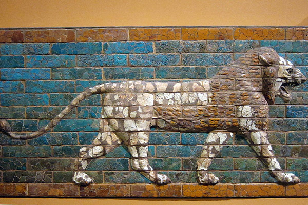 Striding lion once decorating  a side of the 'Processional Way' in Babylon, Iraq. Molded and glazed baked brick.  Neo-Babylonian Period, ca. 604-562 B.C. Chicago Oriental Institute Museum, US.