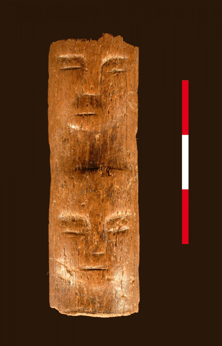Wand with a face carved into it . 7000 BC,  Tell Qarassa, Syria. Photo: Ibanez et al, Antiquity, 2014