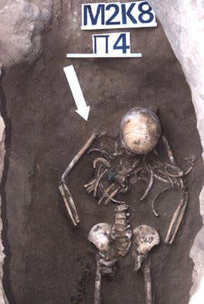A young female warrior's burial from Pokrovka, Russia. The green material on her chest is an amulet holding a leather pouch worn around her neck which held a bronze arrowhead. Her dagger is by her right femur. Photo: Jeannine Davis-Kimball.