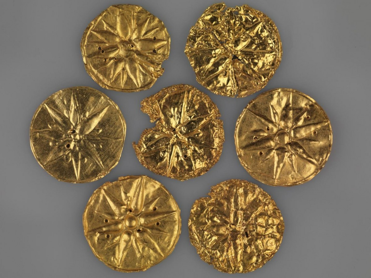 Circular pieces of gold leaf once sewn on a now lost garment and decorated with the so called
