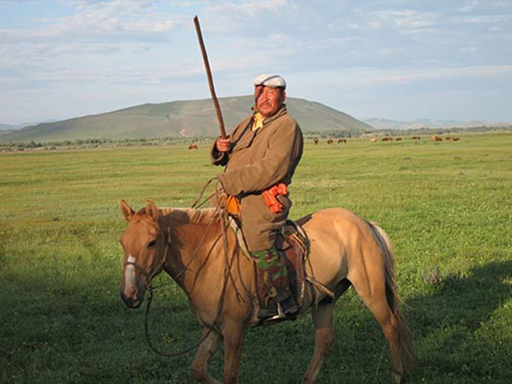 A modern Mongol on horseback. Photo: Kevin Krajick/Earth Institute, Columbia University.
