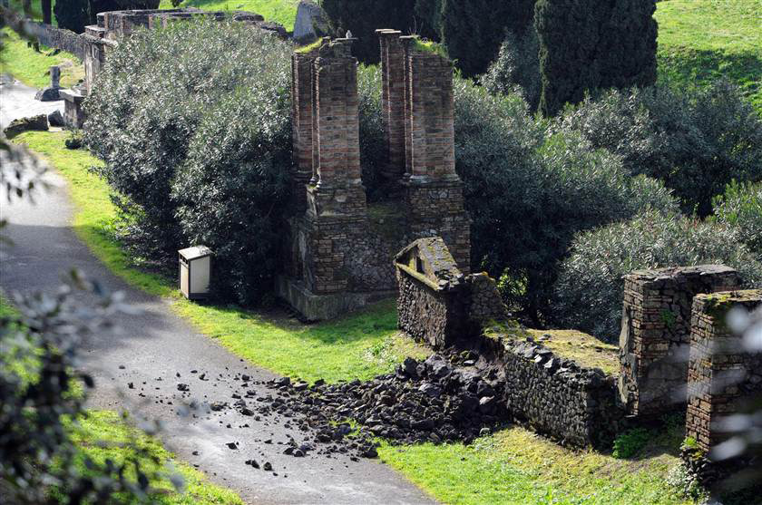 Recent photo from the necropolis of Porta Nocera, Pompeii, showing damages on the wall of a tomb. Getty Images.
