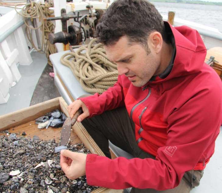 Dr Jonathan Benjamin working in the field.