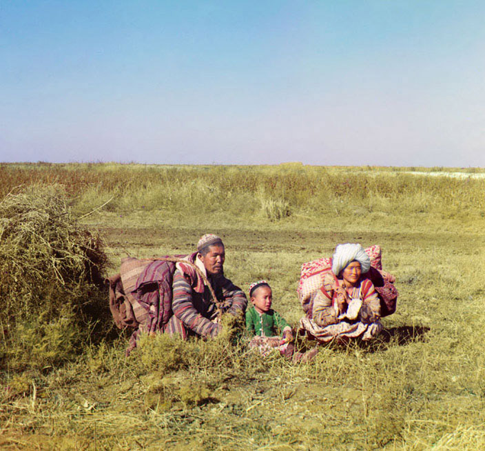 Family of Kazakh nomads. Photographed in 1911 moving across the Golodnaia steppe in present-day Uzbekistan and Kazakhstan. Photo by Sergei Mikhailovich Prokudin-Gorskii. Digital colour rendering. Library of Congress website.