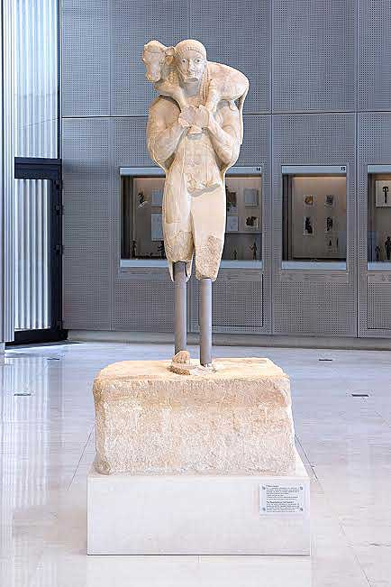 The Moschoforos: Its massive leg props have been replaced with light metallic ones, which significantly improve the aesthetics of the exhibition of the sculpture. (Source: Acropolis Museum)