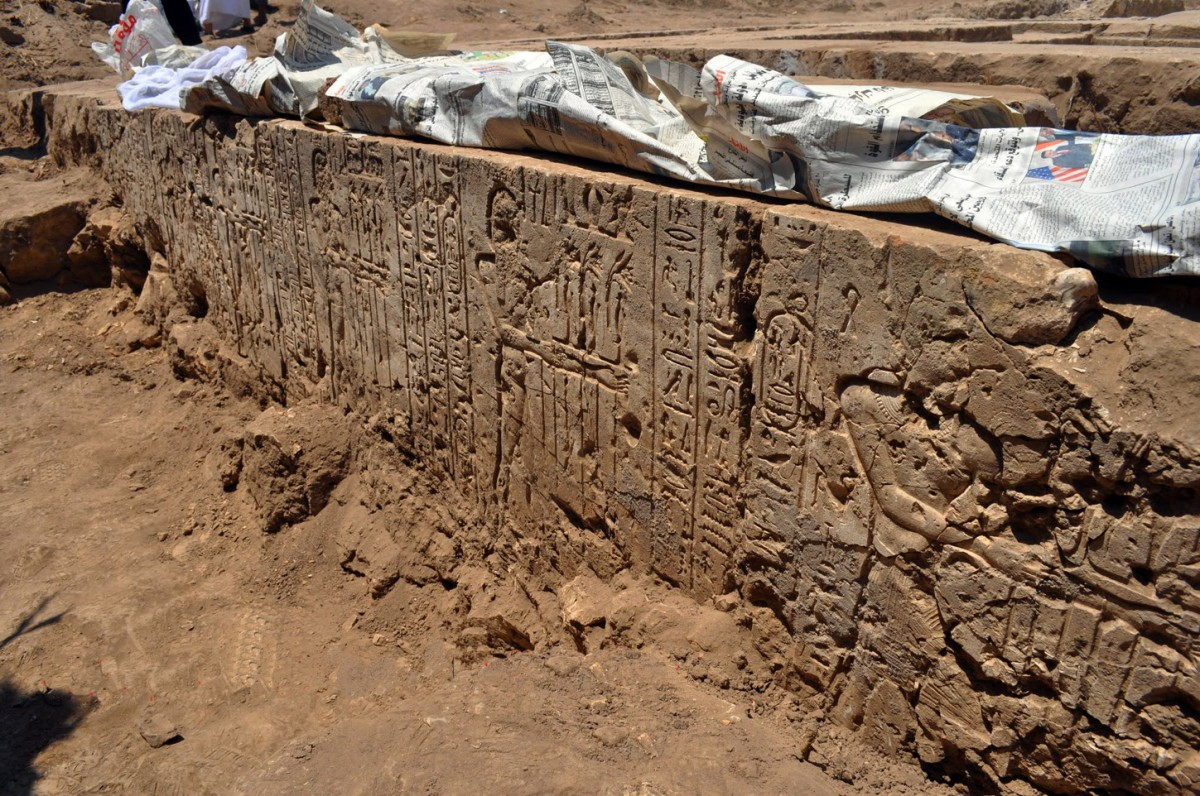 Pharaonic figure followed by  figures of Nile gods, known also as fecundity figures. The cartouche is that of Ptolemy II Philadelphus. Gebel El-Nour, Egypt. Photo: Luxor Times magazine.