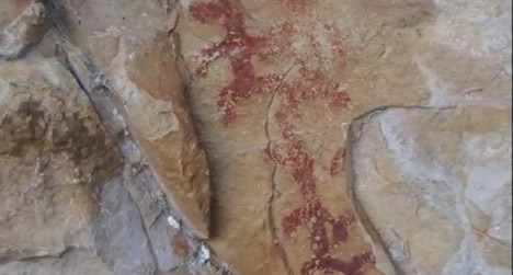 The destroyed part of a rock art panel in Los Escolares Cave, Andalusia, Spain.