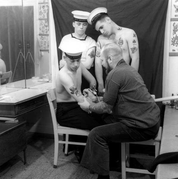 Herbert Hoffmann tattooing Canadian marines of the aircraft carrier Bonaventure, Herbert Hoffmann, 1966.