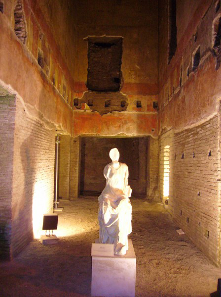 The Domus Aurea. Built following the fire which devastated parts of central Rome in 64 CE the palace was a vast complex of banquet halls and courtyards. The statue is of a Muse and was found near the site.