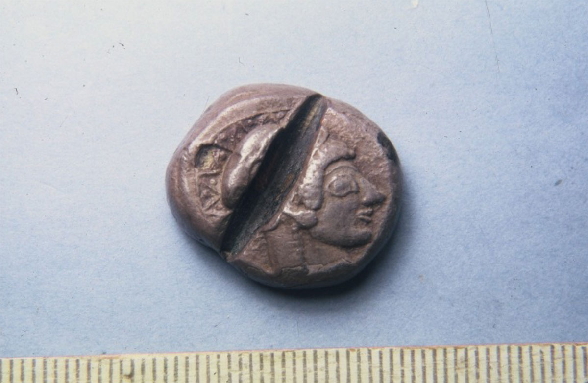 Fig. 6. Counterfeit 6th c. BC Athenian coin. It is a silver plated copper coin that was cut across as counterfeit by the ancient Greek assayer (Numismatic Museum, Athens).