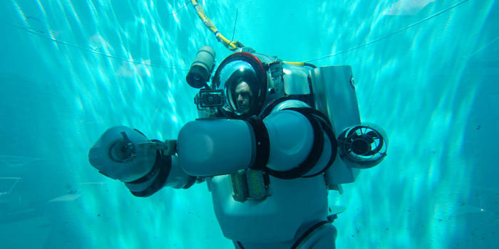 The iron-man looking exosuit allows a diver to descend to 1000 feet for hours at a time without need for decompressing upon returning to the surface. Credit: American Museum of Natural History