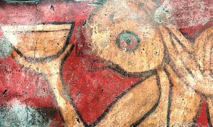 Character holding a pulque bowl in The Drinkers mural. Image: Héctor Montaño INAH