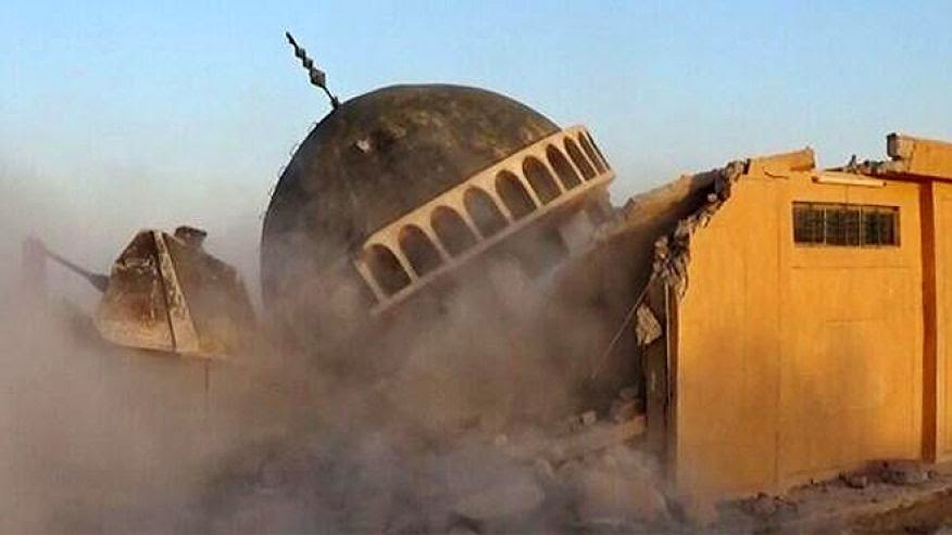 Iraq: A photo posted by ISIS that shows the destruction of what appears to be a Sufi shrine [Credit: Hyperallergic]