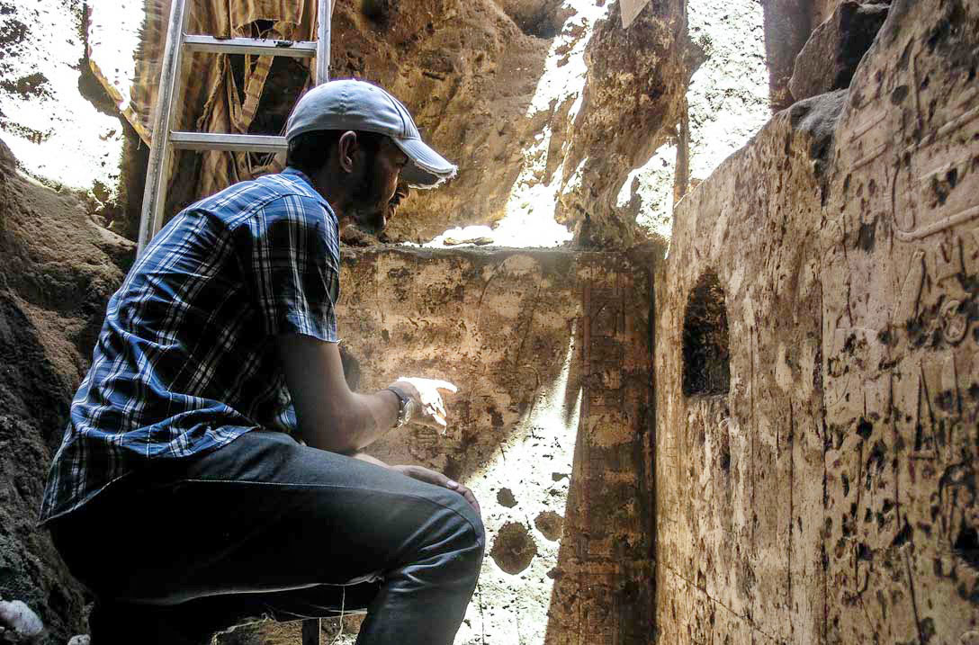 Ayman Damarany of the excavation team in the 11th-Dynasty chapel of Abydos. Photo: Luxor Times Magazine.