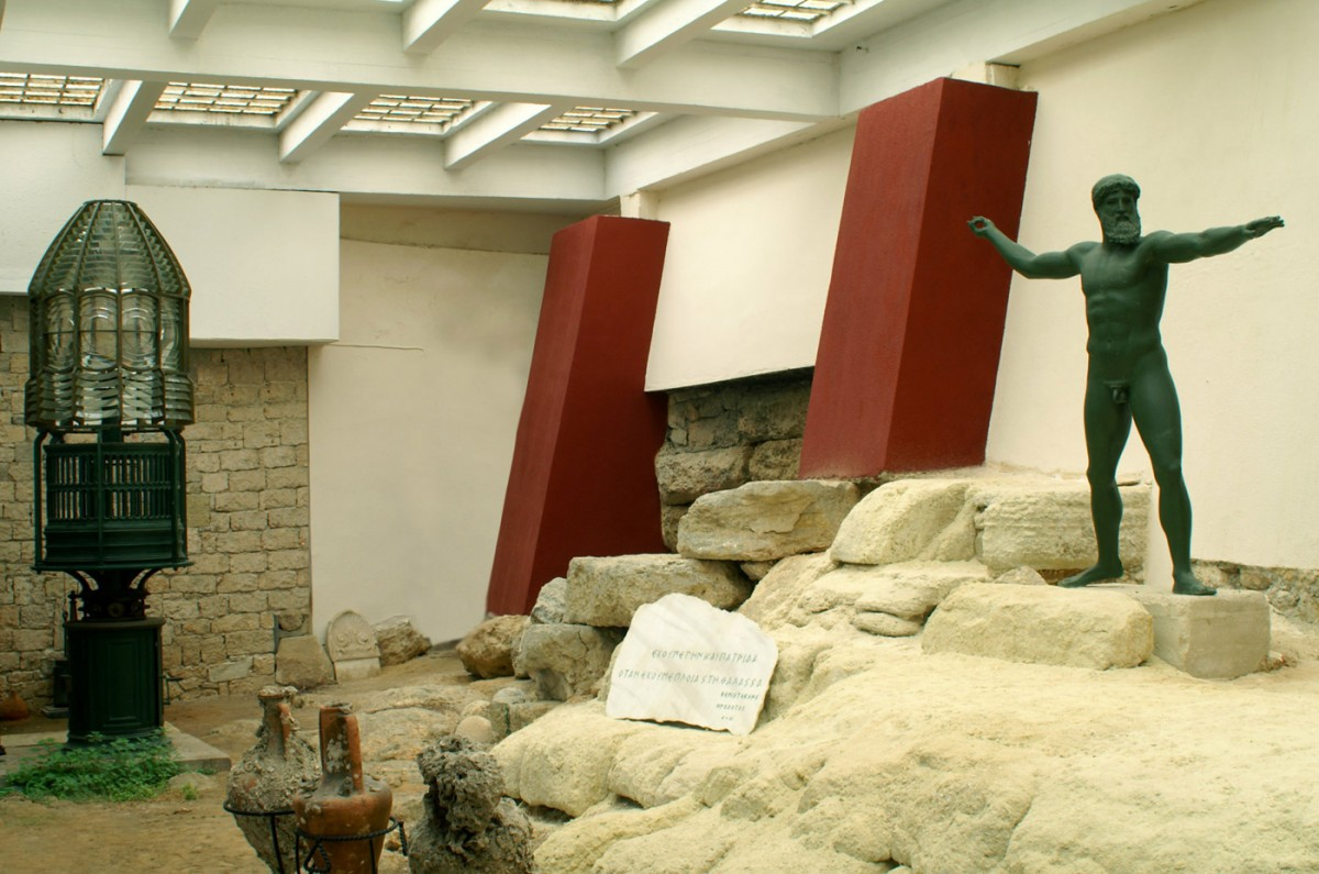 Fig. 15. The characteristic entrance hall of the Museum contains a part of the ancient Conon walls (4th century B.C.) that enclosed the Piraeus coastline.