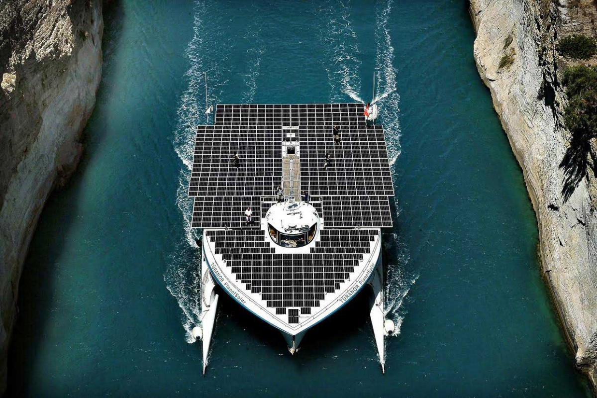 """The world's largest solar-powered boat, """"MS Turanor PlanetSolar"""" sails through the Corinth Canal. Photo: Valerie Gache/AFP."""