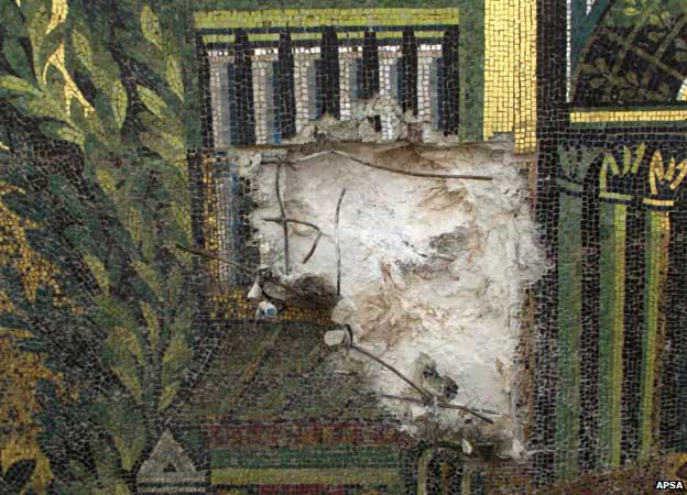 Great Umayyad Mosque: The mosaics depict visions of Paradise with fantastical buildings surrounded by trees and gardens - the Syrian authorities have since repaired the damage. Photo: APSA