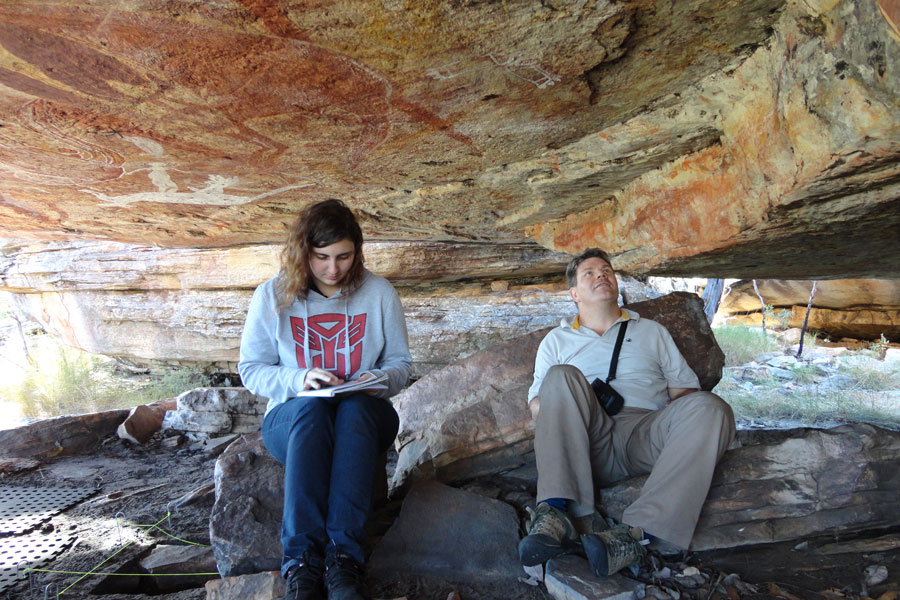 Alexandria Hunt and Dr Paul Thomas at a sacred site in Arnhem Land. Picture by Associate Professor Barbara Stuart.