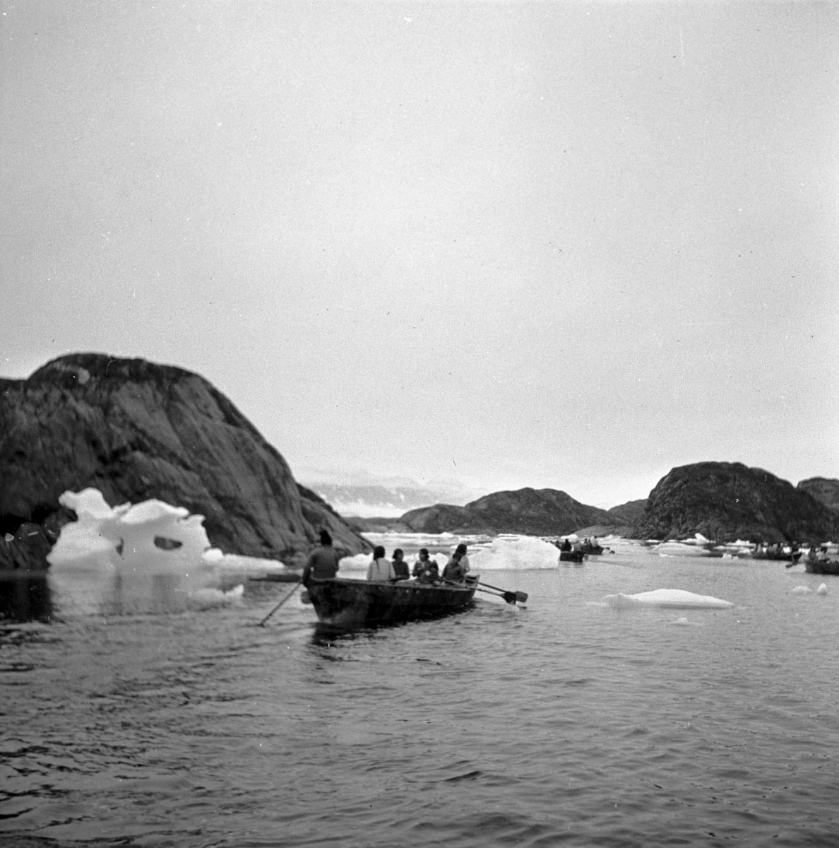 Greenlandic Inuit from the 1930s pictured in their traditional boats (umiaq), used for hunting and transportation. Credit: Jette Bang Photos/Arktisk Institut. Copyright: Arktisk Institut.