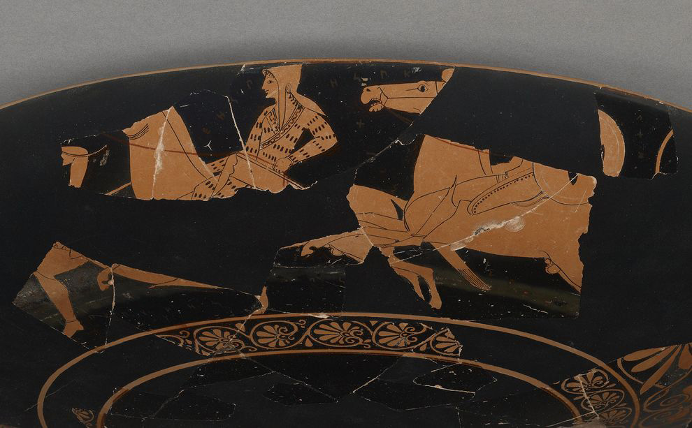 This Greek cup, dating from around 510 B.C., depicts an Amazon warrior on a horse. Scholars suggest wording on the vase names the woman Worthy of Armor in ancient Circassian. Photograph by The J. Paul Getty Museum.