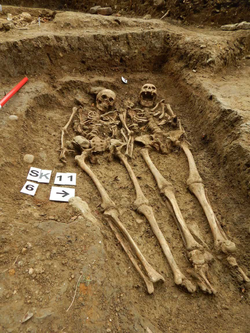 A couple who have been holding hands for 700 years have been uncovered at the 'lost' chapel of St Morrell in Leicestershire. Credit: University of Leicester Archaeological Services (ULAS)