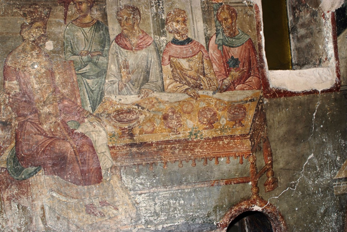 "Fig. 1.  ""Herod's symposium"": Herod sits on a throne with a foot stool, at the head of an especially well ordered rectangular table (wall painting from the church of the Aghioi Apostoloi in Thessaloniki, early 14th century). Κουρκουτίδου-Νικολαΐδου/Τούρτα  (1997)."