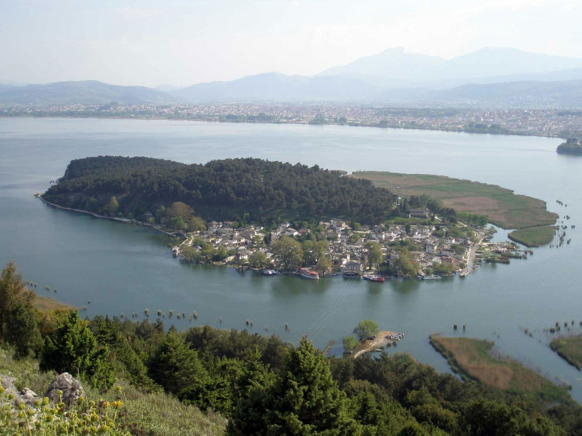Fig. 1. Lake Pamvotis with a close-up view of its island. Further back one can see the city of Ioannina. Mount Olytsika-Tomaros appears in the distance, as it can be seen from the slopes of mount Mitsikeli. (Source: author's archive)