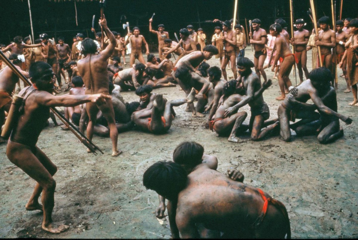 In this mid-1960s photo, men from two Yanomamo villages in the Amazon engage in nonhostile combat to determine the strength and fighting prowess of potential alliance partners. Credit: Napoleon Chagnon