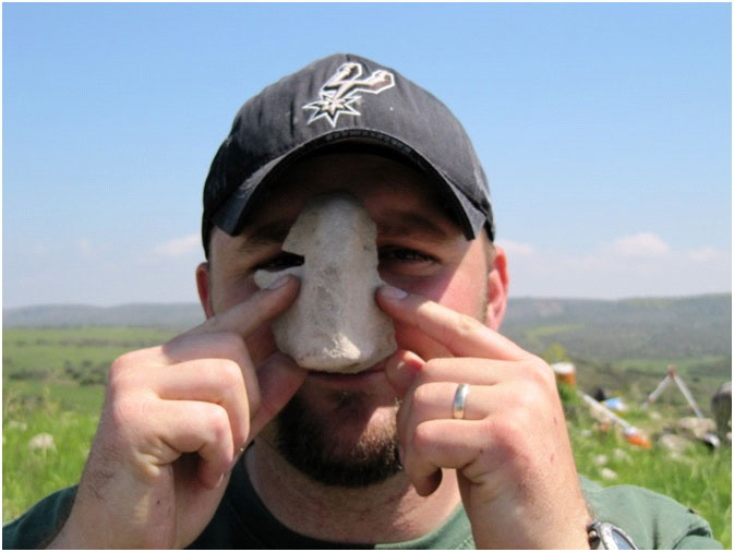 Fragments of facemasks, like this one, were discovered in the 3,300-year-old cult complex at Tel Burna. Credit: Photo courtesy Professor Itzhaq Shai.