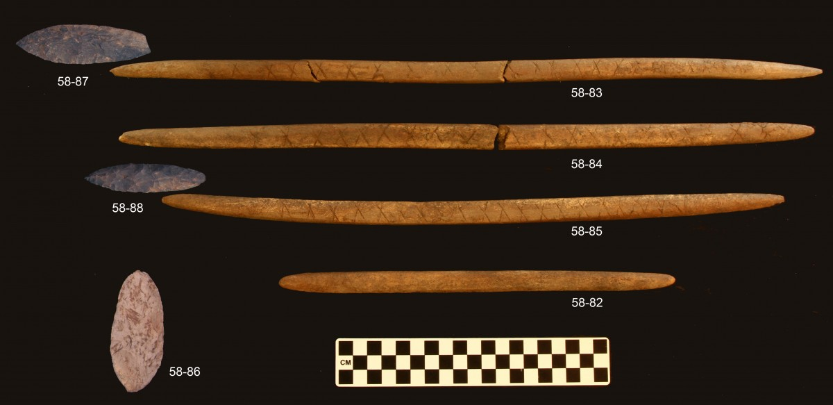 Burial offerings. Stone decorated points and associated antler foreshafts. UAF, photo courtesy of Ben Potter.