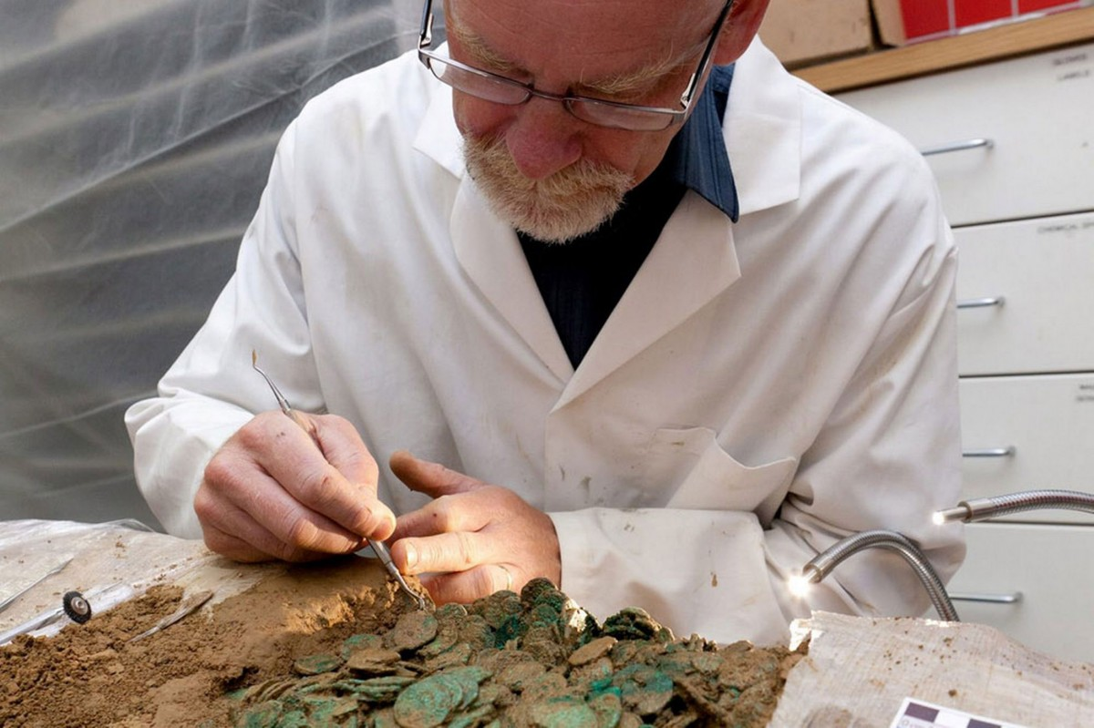 Conservation expert Neil Mahrer working on Le Cantillon II. Photo Credit: Jersey Heritage.