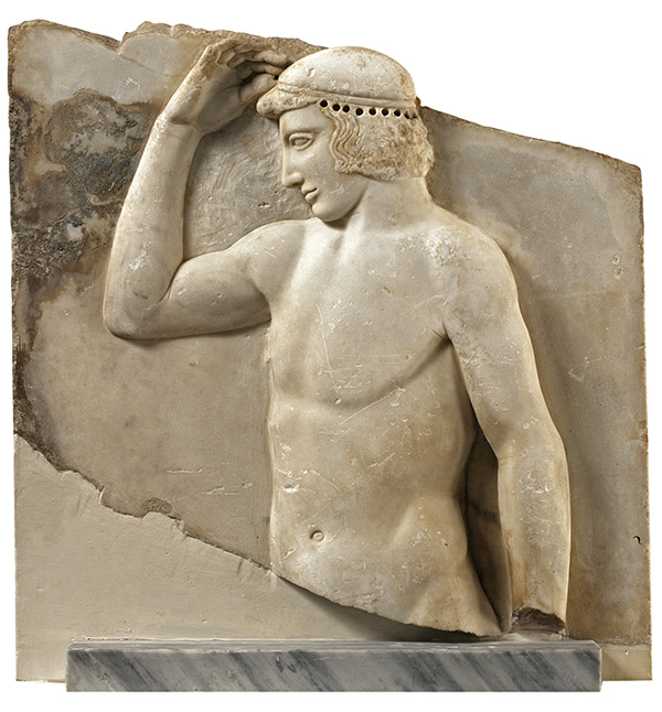 "Votive relief of the so-called ""self-crowning athlete"". C. 460 BC. Parian marble. H. 0.61 m, w. 0.495 m. Found in Sounion in 1915 near the temple of Athena. Athens, National Archaeological Museum, 3344."