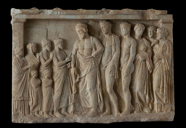 Votive relief. 375-350 BC. Pentelic marble. H. 0.53 m, w. 0.74 m. Probably from the area of Loukou, Kynouria (Peloponnesos). Athens, National Archaeological Museum, 1402.